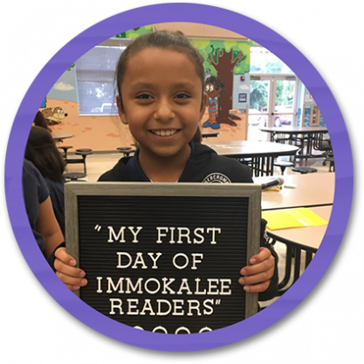 Student Holding first day of school sign