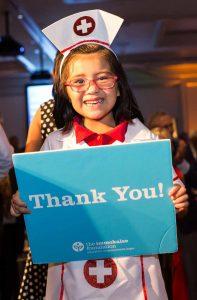 the-immokalee-foundations-immokalee-readers-student-cataleya-vaca-nurse-thank-you-sign