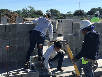 Students learning construction
