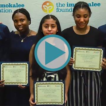 Support The Immokalee Foundation - Students holding diplomas